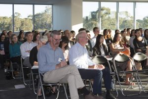 Optometrists listening to speakers at Grand Rounds Event